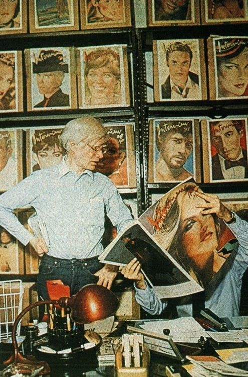 Andy Warhol: at the last, luxe factory (formerly a NYC utility building) with a wall of Interview Magazine covers. early 80s.