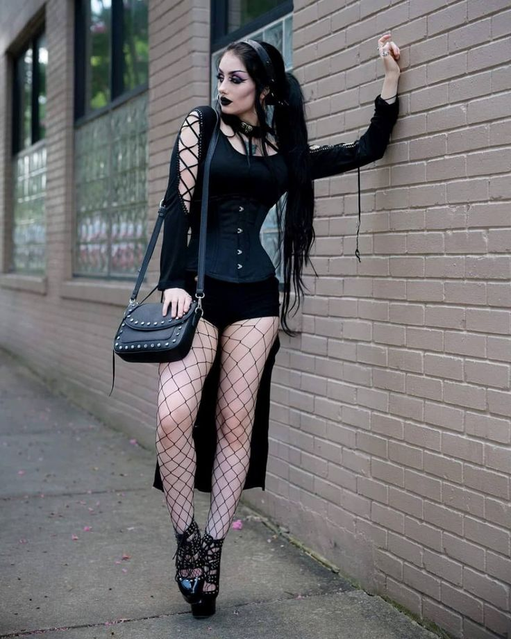 Hot goth chick strips fully nude while smoking cigar