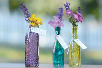 Bring color to the table with these sweet miniature bud vases. They double as a guest keepsake when you add a favor tag and ribbon or twine.