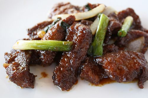 Mongolian Beef Recipe {flank steak, cornstarch, vegetable oil, ginger, garlic, soy sauce, water, brown sugar, rice wine, red pepper flakes, green onions, onion, and Oil for frying.}