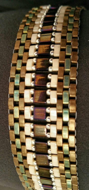 Beautiful handmade Miyuki Tila bead bracelet. Beaded bracelet Tila and half tila beads Multi color Slide clasp Women's Tila bead bracelet by Puckho on Etsy https://www.etsy.com/listing/230635957/beautiful-handmade-miyuki-tila-bead