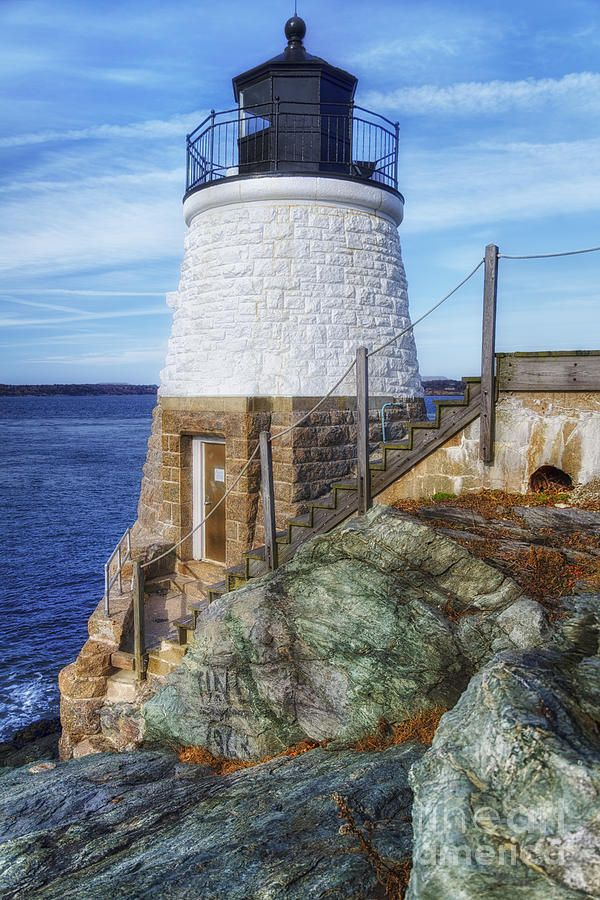 Castle Hill Lighthouse is built right into a cliff face, Narragansett Bay in Newport, Rhode Island.