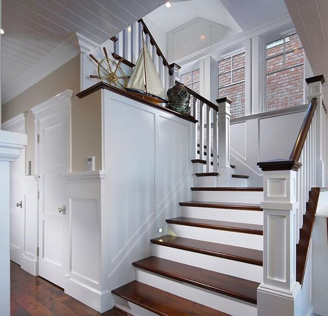 beautiful stair case and great detail on the walls and the ceiling.