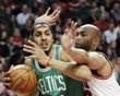 Boston Celtics forward Ryan Hollins (50) looks to a pass as Chicago Bulls forward Taj Gibson (22) guards during the first half of an NBA basketball game in Chicago, Thursday, April 5, 2012. (AP Photo/Nam Y. Huh)
