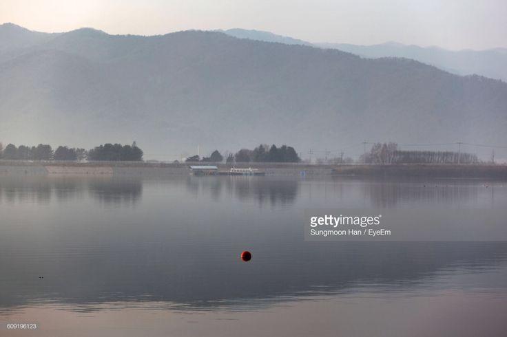 Gongjicheon, Chuncheon, South Korea (Photo by eyepurifier, Alex SM Han)  http://www.gettyimages.com/search/2/image?phrase=Sungmoon&family=creative  #게티이미지 #공지천 #춘천 #겨울 #안개 #의암호 #Gettyimages #landscape #southkorea #winter #Gongjicheon #Chuncheon #park #lake #tranquility #lakeside #ripple #rural #nonurban #reflection #water #fog #season #outdoor #day #nature #foggy #afternoon #lightandshadow #Euiamlake #mountain #island #skyline