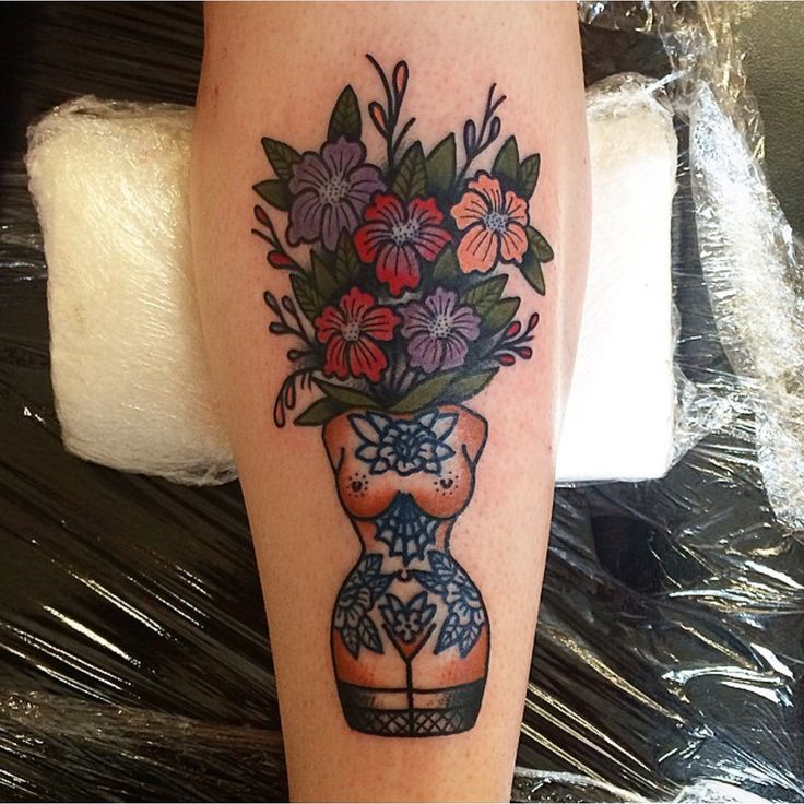 Lil boobs and flowers on my leg by jen at den of iniquity in edinburgh, scotland…