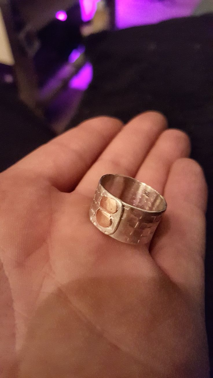 handmade silver ring with copper rivets