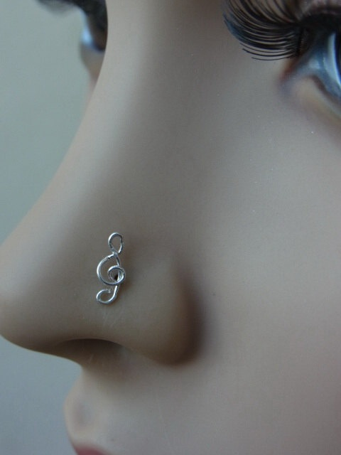 Treble clef silver nose stud by PiercingRoom on Etsy, $8.95.
