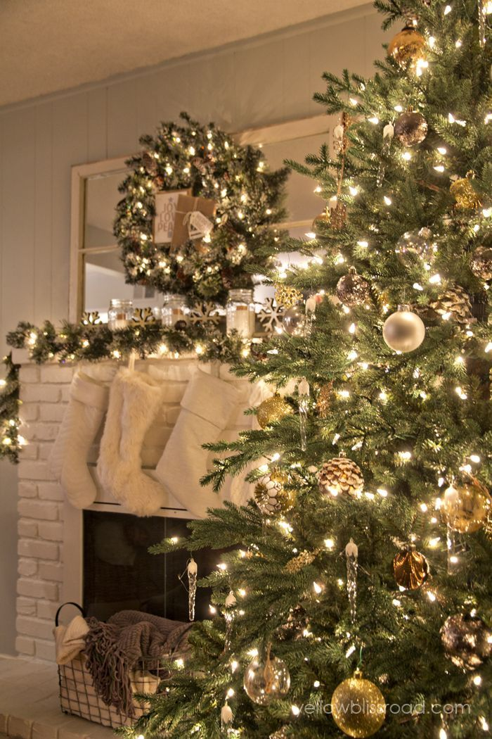 Gorgeous rustic glam style Christmas decor with a lovely sparkly metallic tree and sparkling snowy Christmas mantel decor.