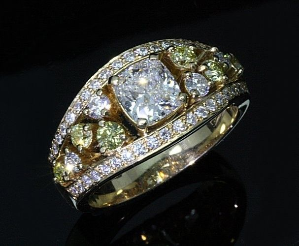 18ct Yellow Gold Diamond Dress Ring. This ring is all handmade and handset. It features a 1.25ct Cushion cut in the center.