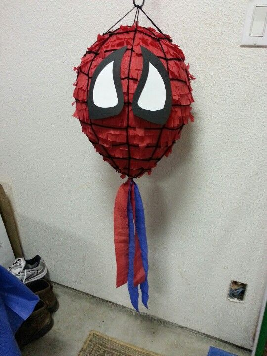 Diy spiderman pinata I made with a balloon and paper mache. Decorated with dollar tree streamers and paper cut out eyes.