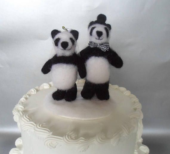 A panda bear wedding cake topper is a fun alternative to the usual plastic figurines. It will certainly add some personality to your cake and afterwards it will be a lasting souvenir of your special day. Looking very elegant, this panda couple is all dressed up. The groom has a mini top hat and a gingham bow tie. The bride has a veil and a white ribbon rose. If you would like to change the colors to match your wedding theme, just send me a convo. Made by needle felting, this unique wedding…