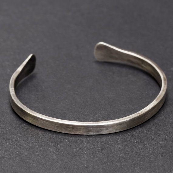 A unisex sterling silver cuff bracelet/bangle with oxidized, satin finish. Handmade by Rebecca Cordingley