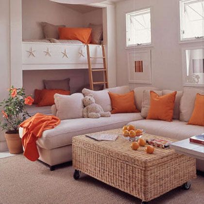 built in beds make this room more of a hang out with a couch as the main space and not the bed, This would be a great space in a basement area, providing extra sleeping room when family comes to visit or for sleepovers. It's orange...too cute.