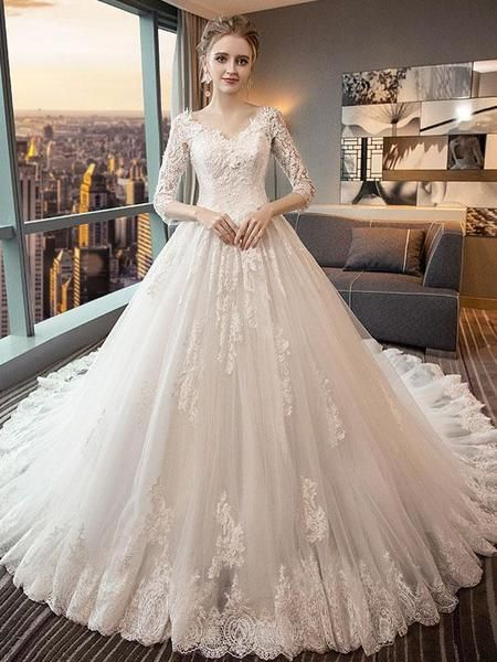 Silhouette A-line 2.Fabric Tulle 3.Embellishment Appliqued 4.Neckline V-neck  5.Sleeve  3 4Sleeves 6.Waistline Natural 7.Hem-length Cathedral Train 8. b2f70a5f8