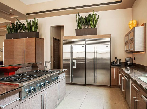 Two large stainless steel fridges are the standout feature in the kitchen.