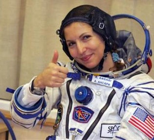 Anousheh Ansari, before Launch to the International Space Station, at Baikonur Cosmodrome, abord the  Soyuz spacecraft: First female tourist, first female Muslim, and first Iranian in orbit.    Sep. 2006.