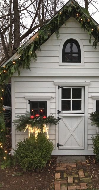 adorable shed all decked out for Christmas.  Love all of the greenery & the…