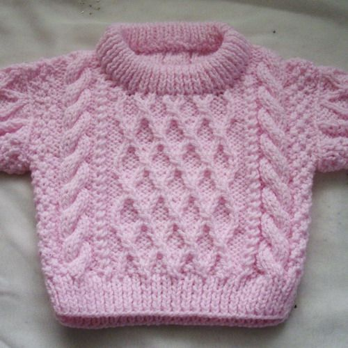 Handknit pink aran cable acrylic sweater for baby