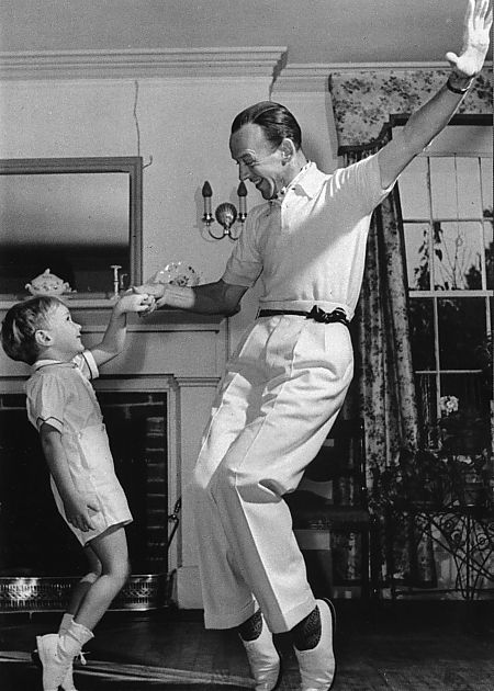 """Fred Astaire dancing with his son Fred Astaire Jr."" There should always be time for dancing around the living room."