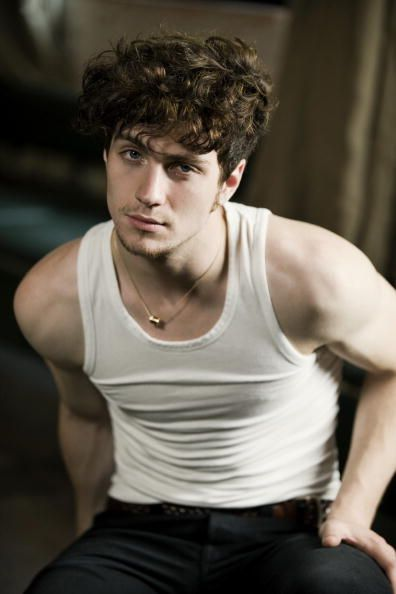 "Aaron Johnson from ""Kickass"". Those cheekbones. Those curls. Those eyes. That soft crackly voice. He's beautiful"