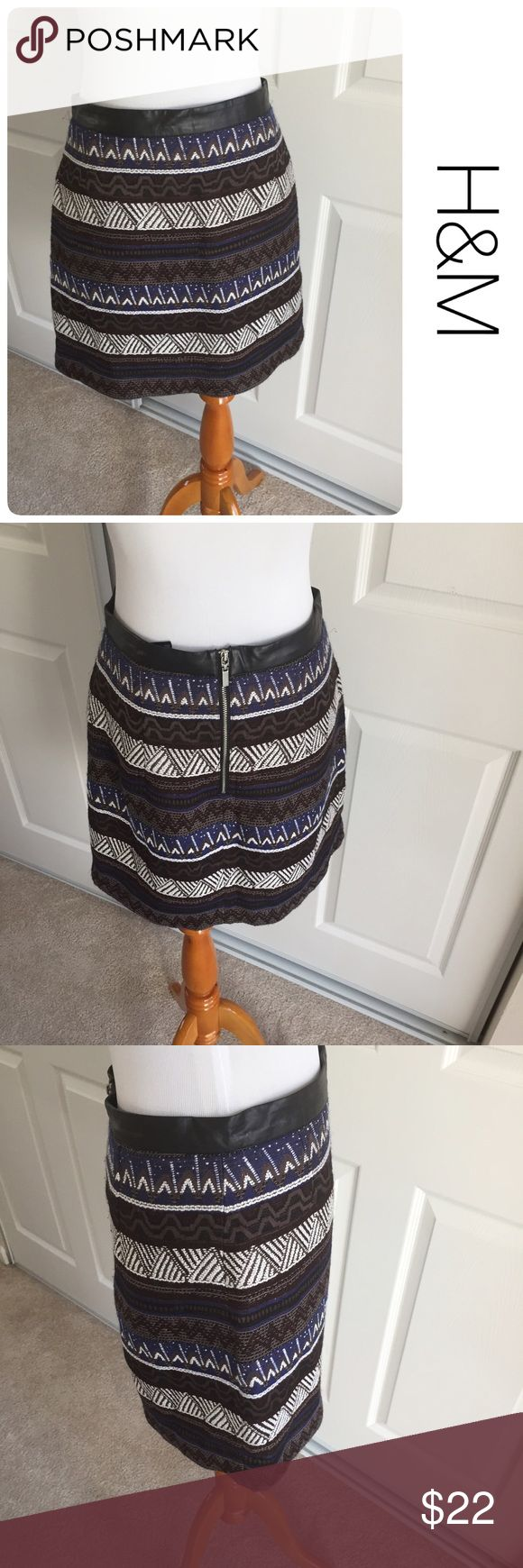 H&M tribal print skirt size 8 ♦️No stains, holes. Minor piling as pictured                                           ♦️Materials- Poly/acrylic blend. See material tag for details                           ♦️Measurements:                                  ♦️Laying flat waist 14 inches                     ♦️Laying flat from top of hem to the bottom of the front hem is approximately 17 inches H&M Skirts Mini