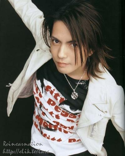 The jacket. The printed shirt. The hair. The smile....xD hyde. Vocals. L'arc en Ciel.