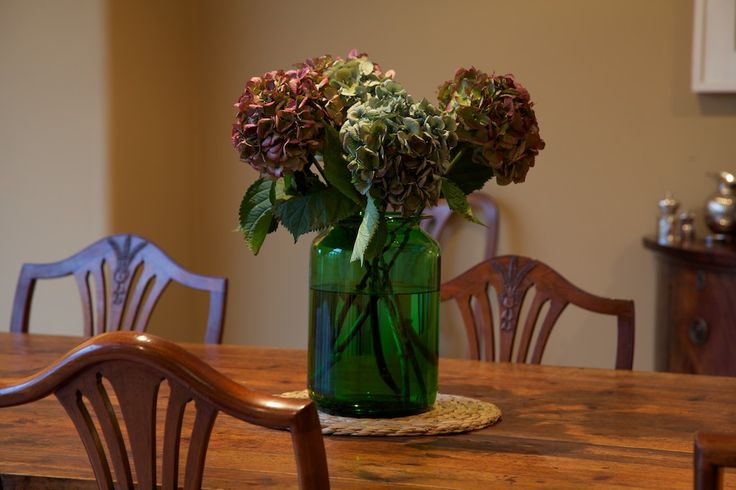 A large green glass vase