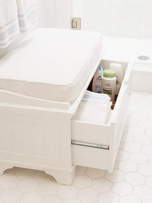 If short on cabinet space, a bench with a pull out drawer provides room for toiletries in a bathroom and is a place to sit to dress and undress with a cushion covered in terrycloth.