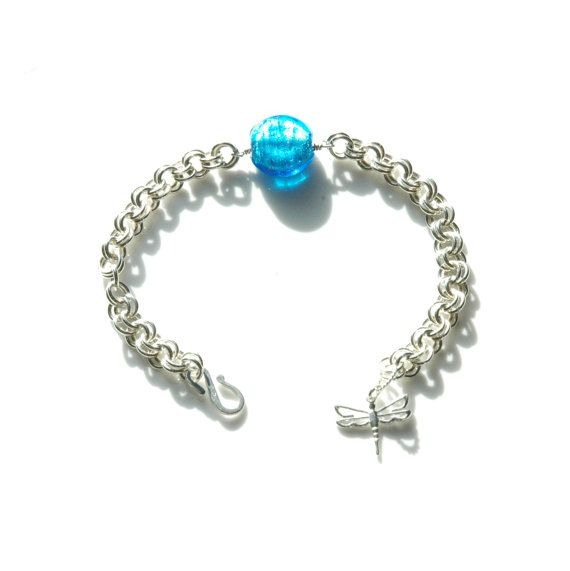 Handmade following the 2-in-2 pattern, from over 50 individually linked rings, with beautiful blue glass beads. This bracelet is 925 Sterling