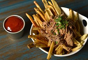 Duck Fat Fries (Confit). Confit is French for huge fat flavor. This dish is served in fancy French cafes. We show you how to pull this off in your faithful Traeger. The idea is to bathe the duck in its own fat to keep it crispy, and make the meat fall-off-the-bone juicy.