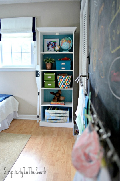 Boy's shared bedroom by Simplicity In The South. Bookcase and art wall.