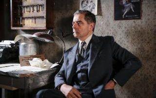 ROWAN ATKINSON as Maigret