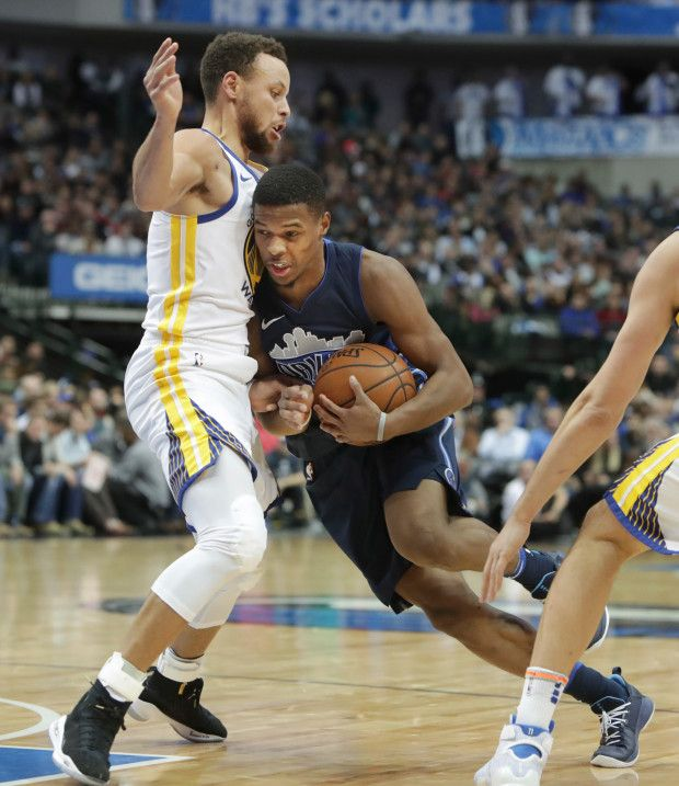 Golden State Warriors guard Stephen Curry (30) defends Dallas Mavericks guard Dennis Smith Jr. (1) during the second half of an NBA basketball game in Dallas, Wednesday, Jan. 3, 2018. (AP Photo/LM Otero)