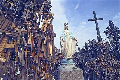 Hill of Crosses-An hour spent upon the sacred hill will reveal crosses brought by Christian pilgrims from all around the world. Rosaries, pictures of Jesus and the saints, and photographs of Lithuanian patriots also decorate the larger crosses. On windy days breezes blowing through the forest of crosses and hanging rosaries produces a uniquely beautiful music.