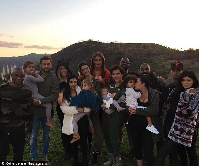 'Thankful for my blended family: Kylie Jenner shared a photo with Mason, Scott Disick, Khloe Kardashian, Kourtney, Kendall, Penelope, Caitlyn, Reign, Kris, Corey, North, Kim, Kanye, Tyga and a friend on Thanksgiving