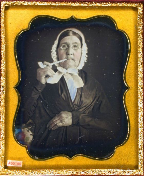 ca. 1850s, [Daguerreotype portrait of an elderly woman smoking a clay pipe] via the Daguerreian Society, Matthew R. Isenburg Collection