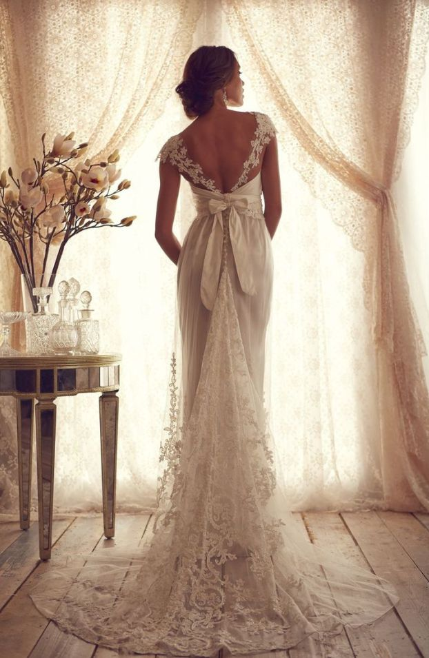 Love the bow + empire, with mostly open back. Anna Campbell Lace