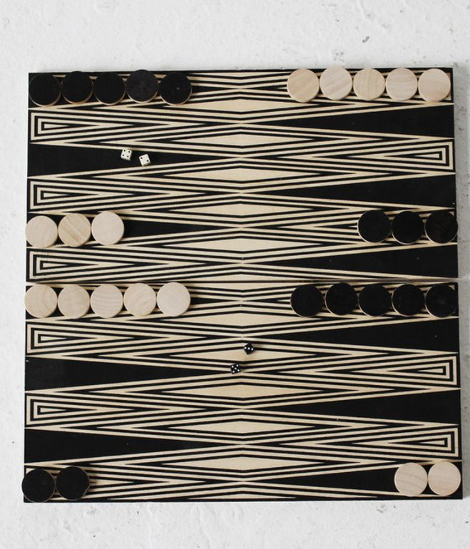 Backgammon is one of the oldest games on record--archeological digs in Iran reveal that similar games were played there around 3,000 BC! This modernized version, on painted baltic birch, includes 30 playing pieces, four dice, and an instructional booklet. $160 at Fredericks and Mae.