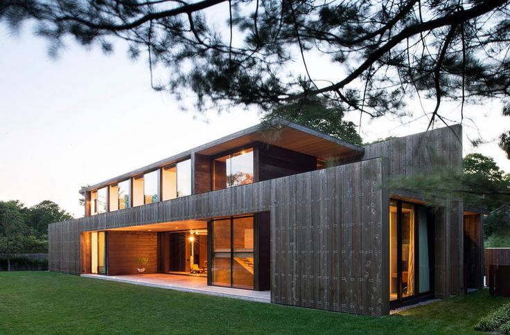 This home in Amagansett, N.Y., features parallel walls that provide layers of privacy and insulation from the sounds of the bustling resort village.