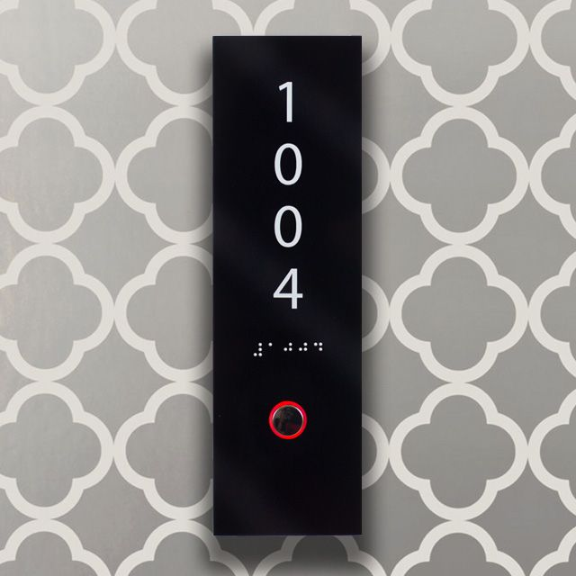 Axxess custom hotel room number sign from the Golden Tulip with LED lit ring indicator and ADA-compliant braille