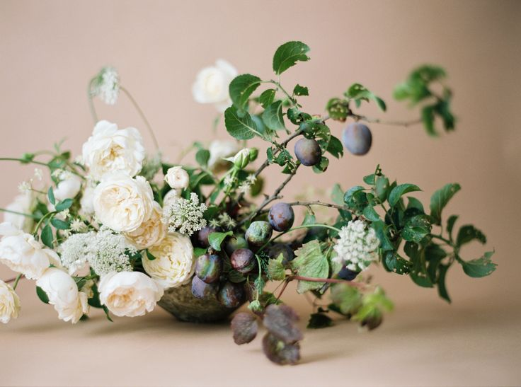 Stunning Ivory and Purple Berry Floral Centerpiece