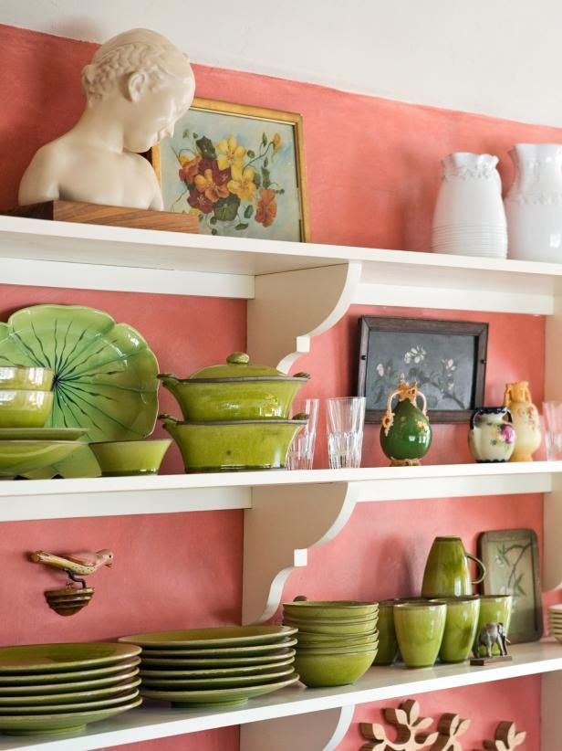 See the open shelving that organizes dishes and knick knacks in this pink cottage-style kitchen on HGTV.com.