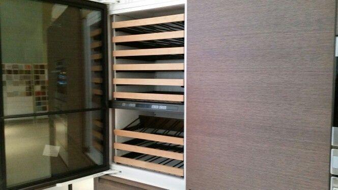 Wine fridge built into a cabinet
