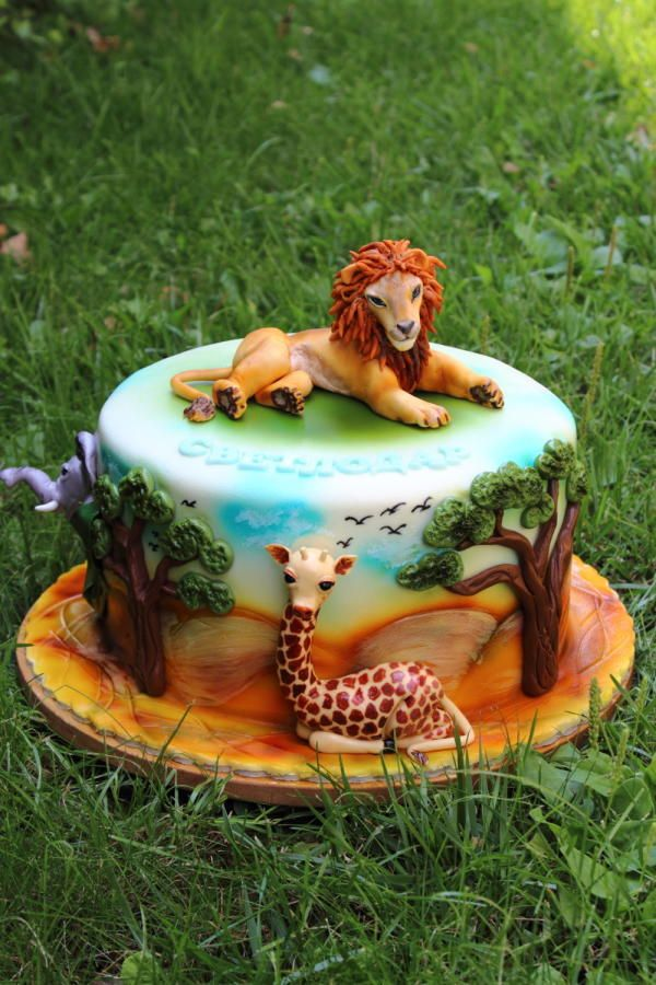 Africa - lion cake topper and giraffe on side of cake. Absolutely gorgeous