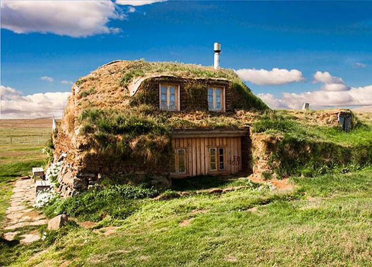 ... ICELAND ... This house is a great representation of what the traditional turf houses of Iceland looked like. Due to the difficult climate of the region, original inhabitants used turf roofs atop a wooden frame for their homes. While this may have been for functional reasons, the result is simply magnificent! It practically looks like the house just rose straight up from the ground.
