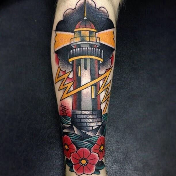 Lighthouse tattoo on back of calf.