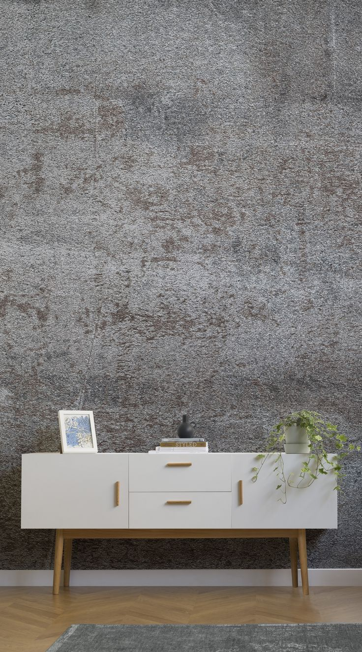 Instantly enhance any wall with the chic silvery sheen of a noble metal. The polished finish of the Burnished Silver Metallic Effect Mural Wallpaper is sure to impress any guest with its subtle industrial quality. Designed by a team of in-house designers, this metallic wall mural sings with style. #wallpaper #murals #wallmurals #interior #design #home #homedecor #decor #accentwall #inspiration