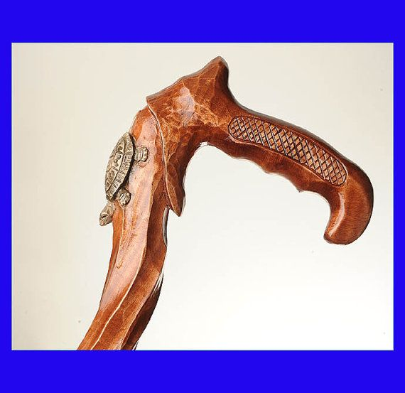 You are bidding on a beautiful, hand-carved wooden cane. The handle has been well carved. Perfect details.    The cane is made from beech wood,