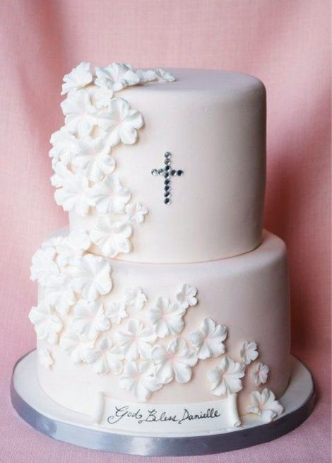 I like the way the cross is subtle, modern and classy. Also the cascading flowers are so pretty and just fine without a topper.